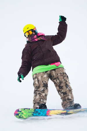 Teen snowboarder on the board Stock Photo