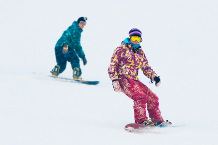 Young girl snowboarder on the board Stock Photo