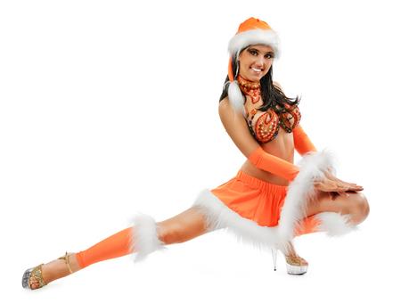 Leuk sexy meisje in Kerst kostuum geïsoleerd op een witte achtergrond Stockfoto
