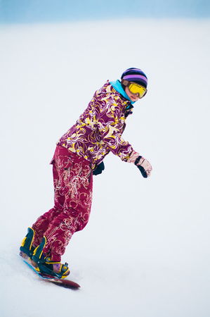 Young girl snowboarder on the board Stok Fotoğraf