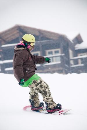 Teen snowboarder on the board Stok Fotoğraf