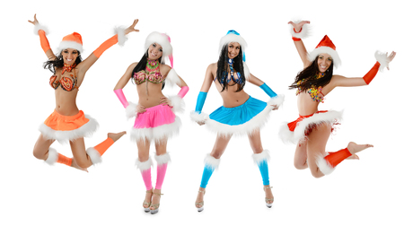 Group of cute sexy girls in christmas costume jumping isolated on white background