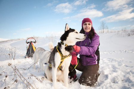 Young woman with siberian husky
