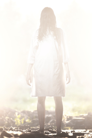 Long-haired scary girl in a white clothes