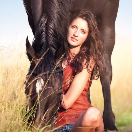 Young beautiful girl with a horse