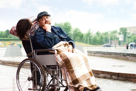 Sad man on a wheelchair