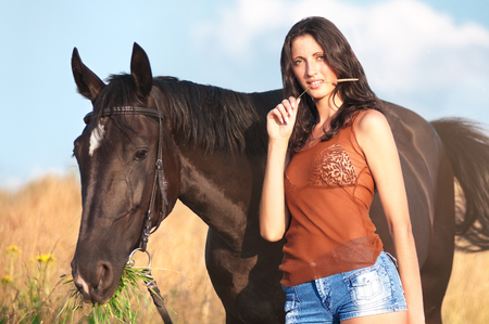 Young beautiful girl with a horse on field Stok Fotoğraf