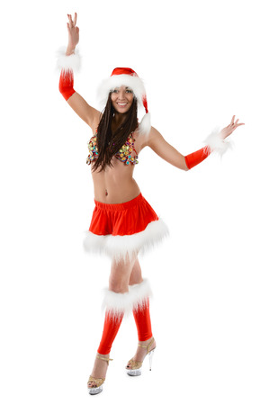 Cute sexy girl in christmas costume isolated on white background
