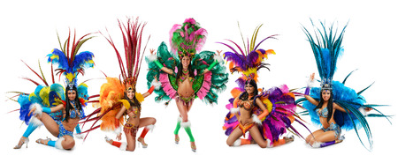 Group of smiling beautiful girls in a colorful carnival costume Banco de Imagens