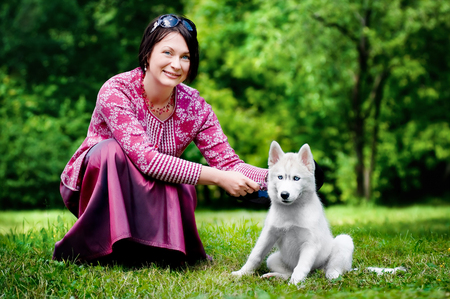 woman with a puppy husky