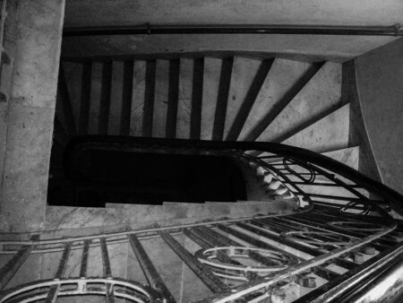 Elegant and dark staircase of an old residence