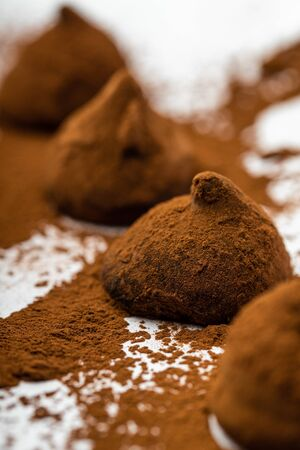 Closeup of weet truffles with cocoa powdre