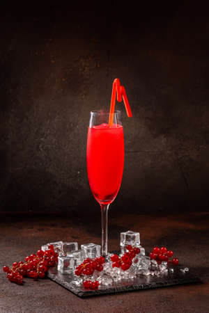 Delicious cold refreshing red smoothie drink in cocktail glass