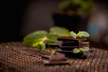 dark or milk chocolate bars with green mint leaf