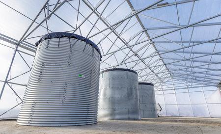Three huge water storage tank in the greenhouse