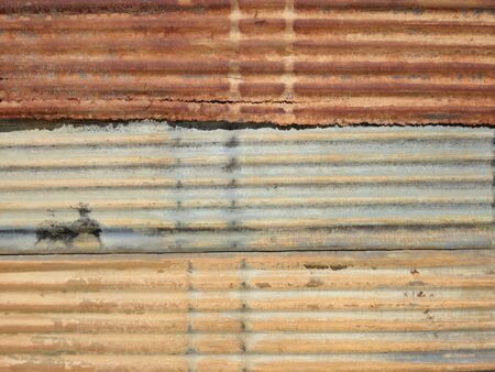 fulfilling: Wall of corrugated iron sheet in a poor district of Inhambane, Mozambique, Africa Stock Photo