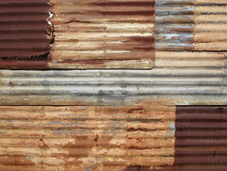 Wall of corrugated iron sheet in a poor district of Inhambane, Mozambique, Africa Stock Photo