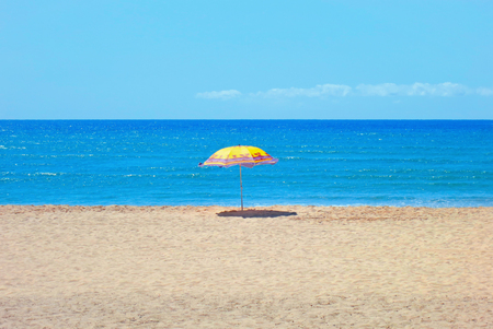 southern indian: White sandy beach, sea and blue sky with umbrella
