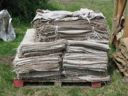 Stack of jute sacks. Used against a high flood in Gartow. Wendland, Lower Saxony, Germany; Europe