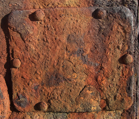 Rusty brown metal sign with rivets. Detail of a shipwreck at the beach of in Beira, Mozambique, Southern Africa Stock Photo
