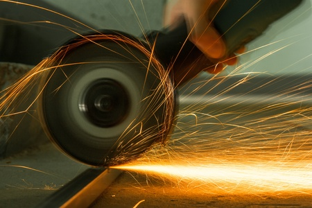 Red hot sparks at grinding steel material photo