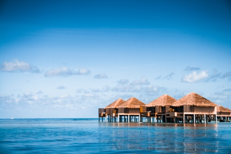 vacation destinations: Over water bungalows with steps into amazing green lagoon