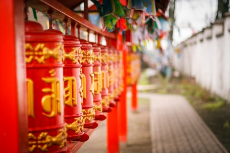 Line of red praying drums at datsan photo