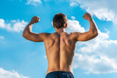 the won person with the raised hands against the sky. view from a back Stock Photo - 20894492