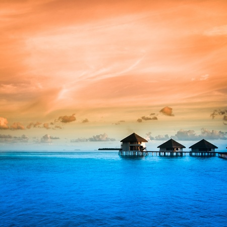 Over water bungalows with steps into amazing green lagoon Imagens - 21156838