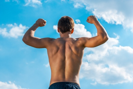 the won person with the raised hands against the sky. view from a back Stock Photo - 21160788