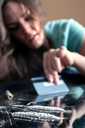Young woman and two line of cocaine Stock Photo