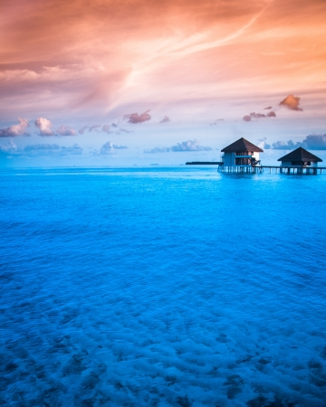 bora bora: Over water bungalows with steps into amazing green lagoon