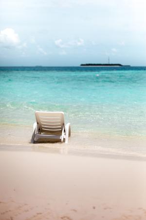 chaise lounge on a beach of mediterranean sea in barcelona, spain, catalonia photo