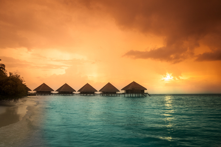 resorts: Over water bungalows with steps into amazing green lagoon