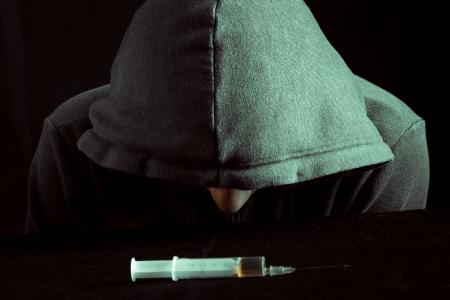 Grunge image of a depressed drug addict