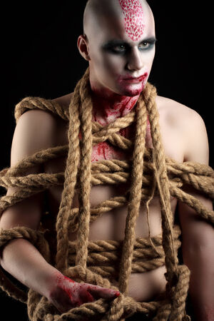 male model with ropes around his body photo