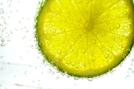 lime slice in water Stock Photo