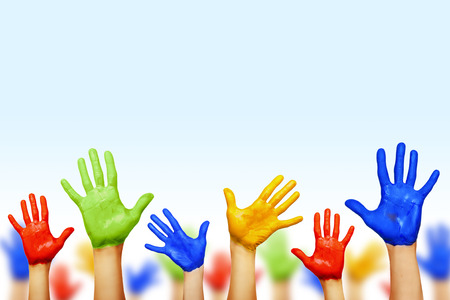 Kleurrijke handen op wit wordt geïsoleerd Stockfoto