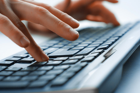 Image of mans hands typing. Selective focus Stock Photo
