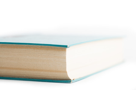 Isolated closed book with a few bookmarks photo