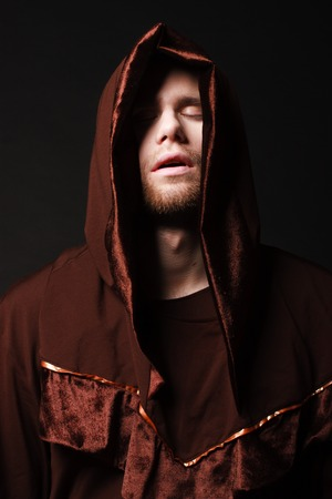 mysterious Catholic monk. studio shot photo