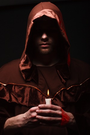 mysterious Catholic monk. studio shot Stock Photo