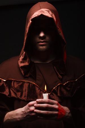 cassock: mysterious Catholic monk. studio shot Stock Photo