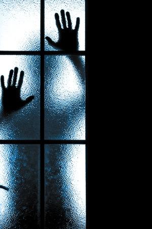 Scary figure behind glass door  photo