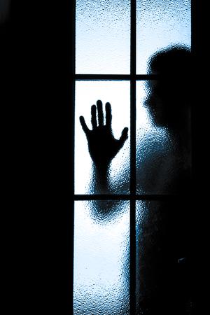 scary figure behind glass door. photo