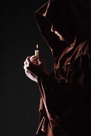 mysterious Catholic monk  studio shot Stock Photo