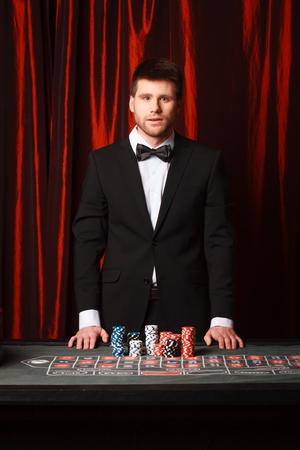Man placing a bet at the casino., studio shot photo