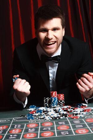 man playing at the casino. studio shot
