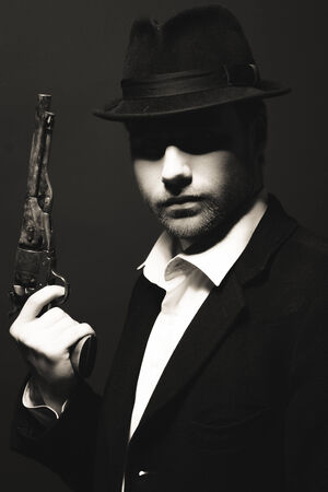 The man in style Chicago gangster with gun  photo