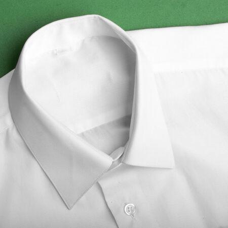 Fold white long sleeves shirt.  photo